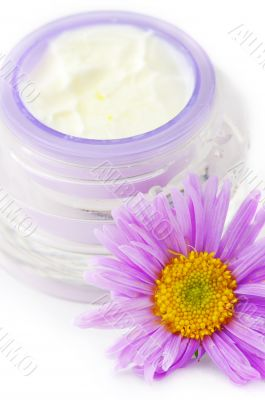 Closeup of open container of cosmetic face cream on white backro
