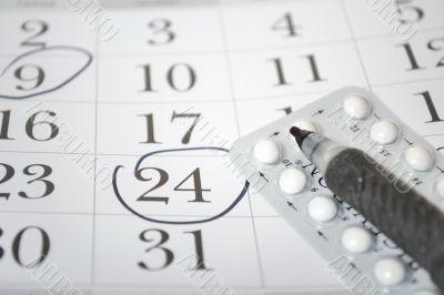 Birth control pills and pen