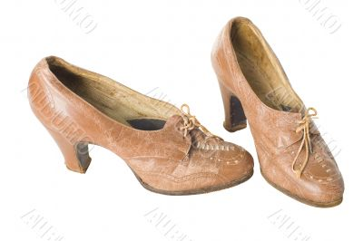Old vintage traditional womans shoes isolated with clipping path.