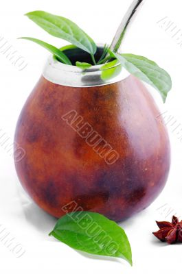 Isolated Leather Mate Cup with Straw and yerba green leafs