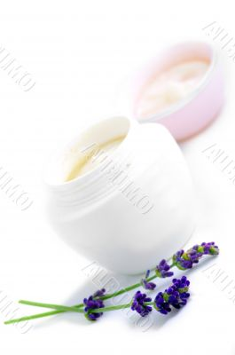 Closeup of open container of cosmetic face cream