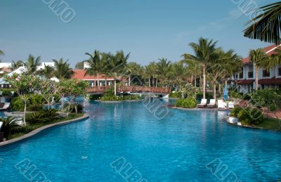 A beautiful large swimming pool at a local resort