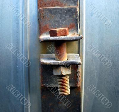 rusty screw and nut closeup