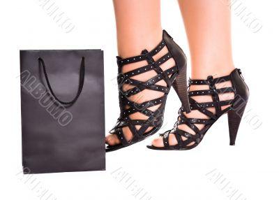 women legs kick shopping bag