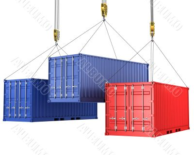Three freight containers are being hoisted