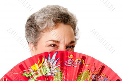 Senior woman with red dragon fan