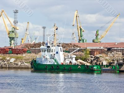 the green tugboat in the trade port