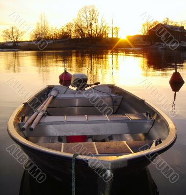 Golden Boat on Sunset in Finland