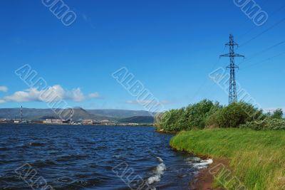 factory on coast of lake