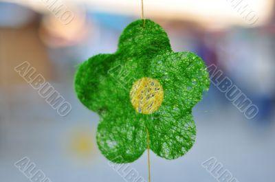 green textile flower