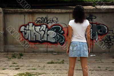 The beautiful girl against graffiti.