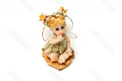 Souvenir figure of the little fairy. Isolated on a white backgro
