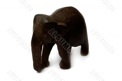 Souvenir figure of a wooden elephant. Isolated on white backgrou