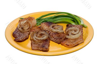 juicy steak with onions on a plate