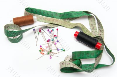thread, needles and tape for sewing set