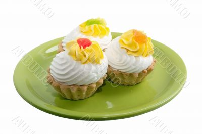 green plate with pastry cream isolation