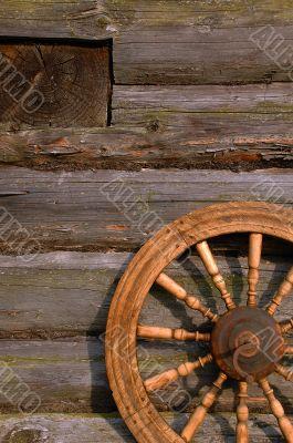 Spinning Wheel On The Log Hut Wall