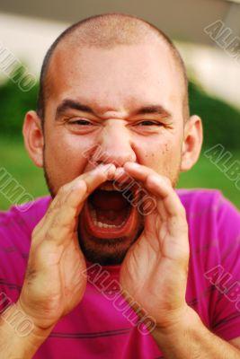 Closeup of a young man screaming