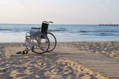 Wheelchair on sandy seacoast