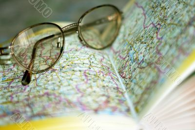 spectacles on page geographical atlas