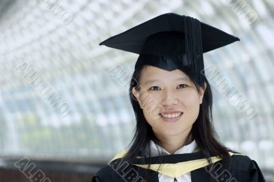 Smiling asian chinese lady graduate