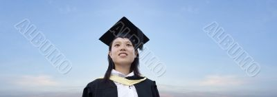 Asian lady graduate look up with panoramic sky