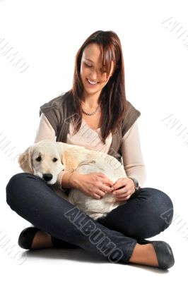 puppy golden retriever and woman