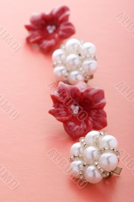 costume jewel earrings on red