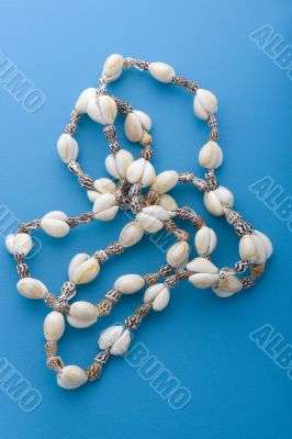 costume jewellery beads on blue
