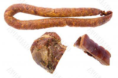 Smoked sausage and pork gammon on white background