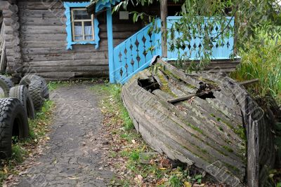 Old Shabby Boat and the House