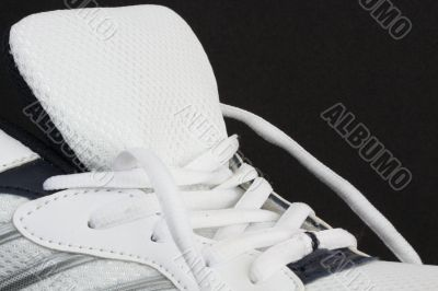 Trainer showing laces