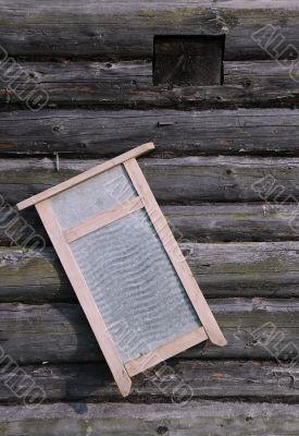 Washboard on Old Log House Wall