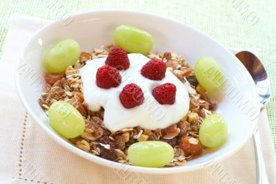 Healthy breakfast with muesli, yoghurt and berries
