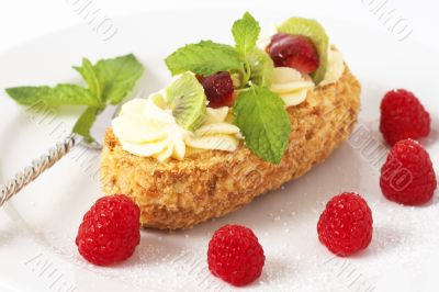 Fruit boat cake with raspberries