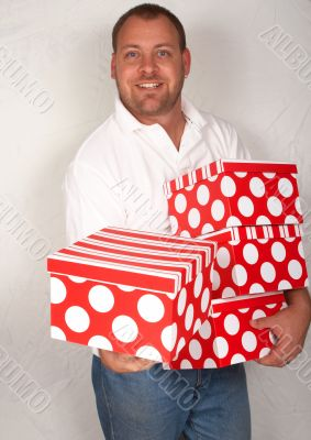 Adult Caucasian man with Christmas boxes