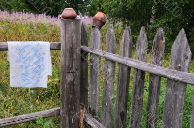 Clay Pots and Towel on the Fence