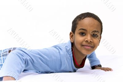 Portrait of a young boy raising his head