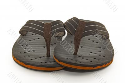 Brown flip flops on a white background
