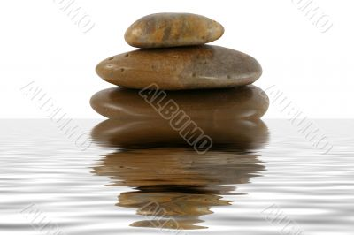 Stack of zen rocks with water reflection