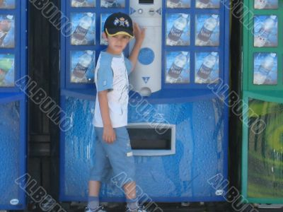 boy in front of beverage dispenser