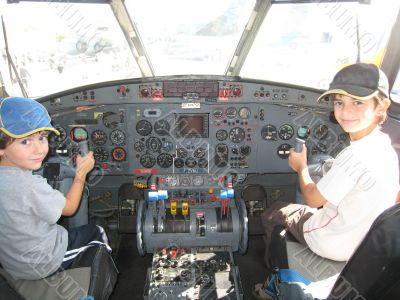 two boys in a cockpit