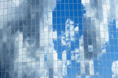 Sky reflected in skyscrapers windows