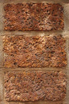 Three red bricks