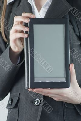 Girl holding an electronic book reader