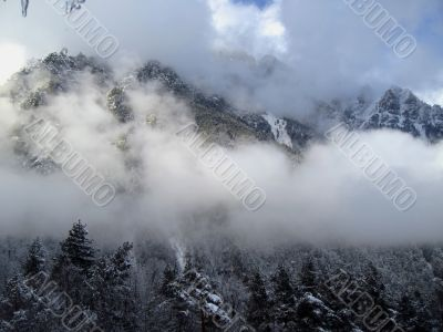 Clouds between the mountains