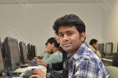Adult professional in computer class