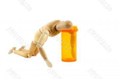 Manikin reaching in pill bottle