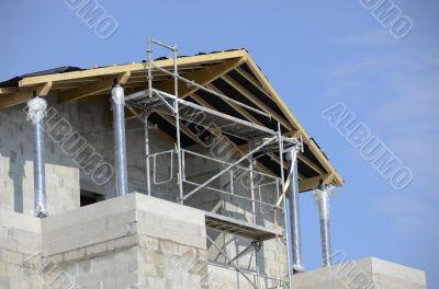 house under construction against a blue sky