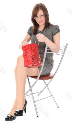 The woman looking in bag.